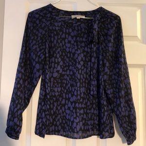 Long sleeve leopard print blouse.